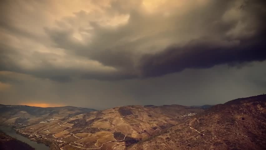 Cinemeagraph Loop - Storm filled sepia sky behind mountain range - motion photo