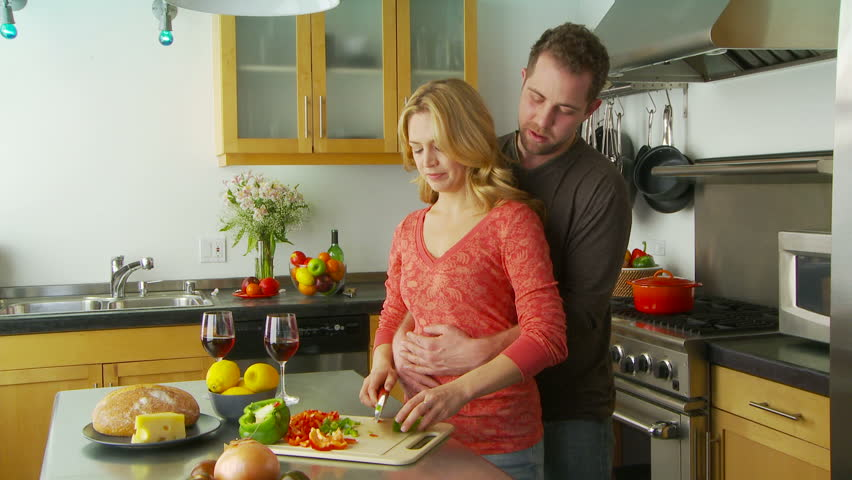 Young couple being playful and romantic in kitchen - HD stock footage clip