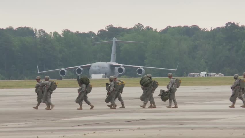 BASE CHARLSTON, MAY 2015, US Air Force Soldiers Walk Over Airfield