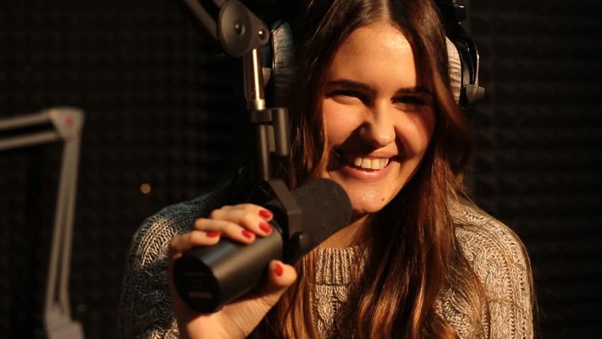beautiful girl dj radio hamming in studio - HD stock footage clip
