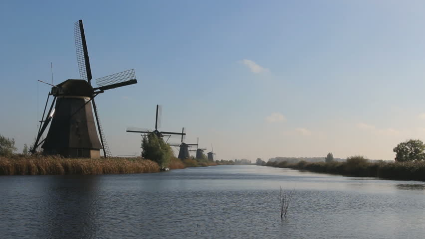 Colorful Autumn morning on the canal in Netherlands Dutch windmills at Unesco Kinderdijk - HD stock video clip
