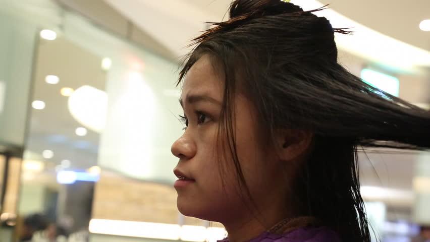 Asian Beauty Salon Combing Client's Wet Hair In Salon ...