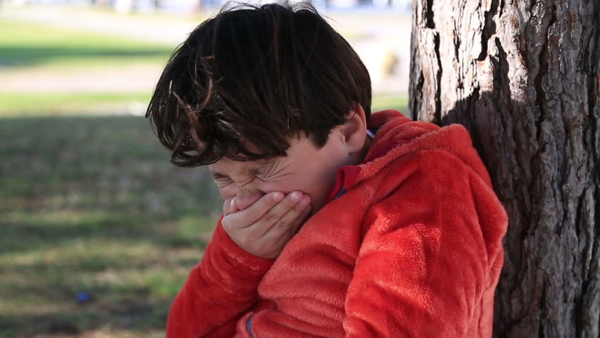 Sick young boy sneezing - HD stock video clip