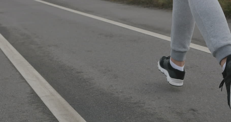 Legs, back running athlete. Shot with Steadicam, the movement for the running man. | Shutterstock HD Video #12592895