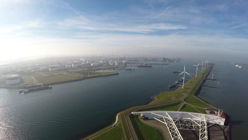 Drone aerial footage of Rotterdam Harbor above Maeslantkering storm surge barrier on Nieuwe Waterweg waterway and wind turbines generating renewable energy piece of Delta Works Werken Deltaworks 4k #12602480
