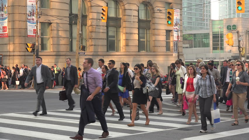 TORONTO, ONTARIO/CANADA - SEPTEMBER 03, Unidentified business commuters cross Front Street from Union Station. The station is the busiest station in Canada, with over 250,000 passengers a day.
