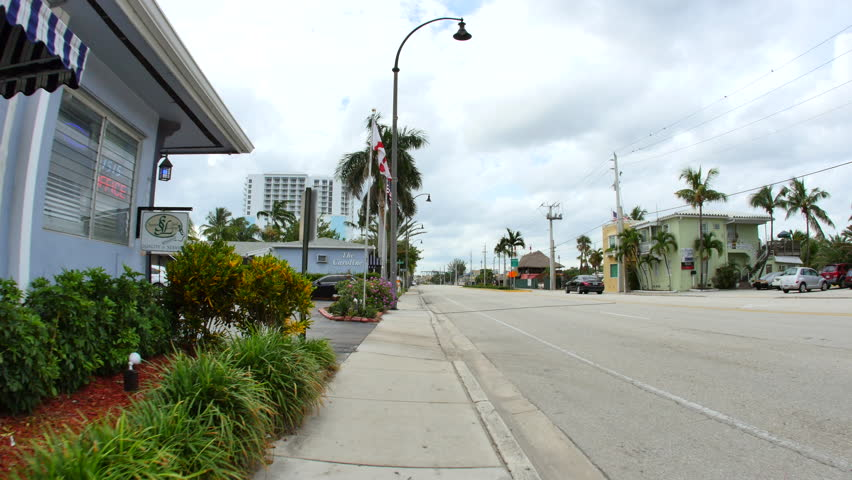 HOLLYWOOD - NOVEMBER 4: Motion video of streets of Hollywood Beach FL shot with a gimbal stabalized camera November 4, 2015 in Hollywood, FL, USA - 4K stock footage clip