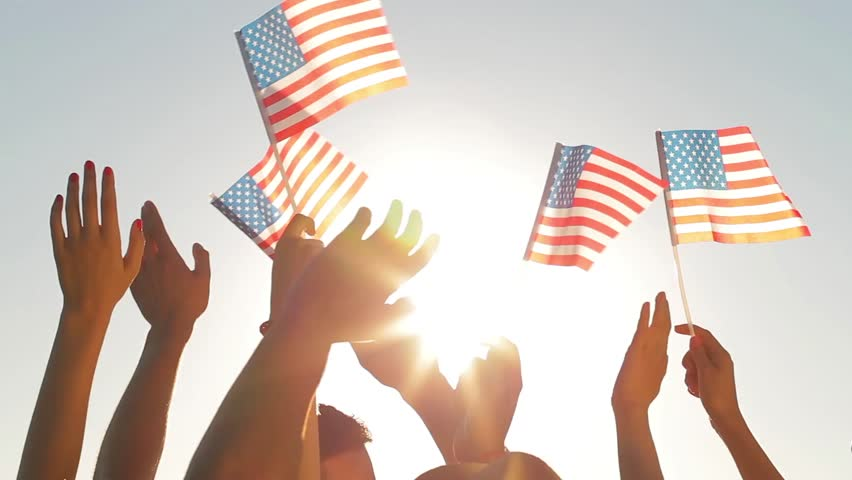 People waved flags. Fans with American flags. Patriots waving flags of America. People at sporting events supported by America.   Shutterstock HD Video #12666056