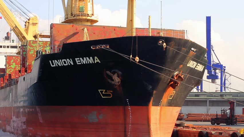 ISTANBUL - JUL 15, 2013: (Close-up view) General cargo ship Union Emma (Flag: St Vincent Grenadines - VC, Home port: Kingstown) docked in port. Dry cargo ship unloading in seaport