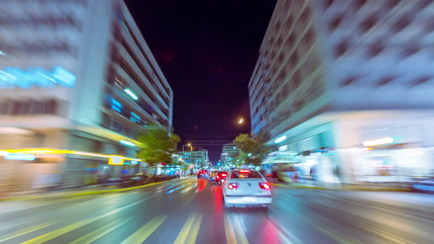 4K 25p Athens city drive pov night drive timelapse/hyperlapse.Shot at downtown and central Athens,from outside the windshield of a car at eye level.Commercial version, no logos/licence plates visible. | Shutterstock HD Video #12684137