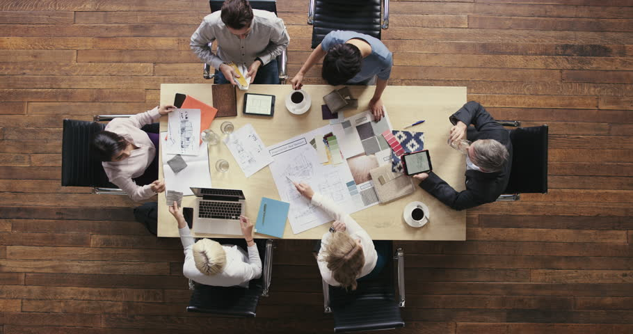 Top View of Business people meeting around boardroom table discussing textiles for new sustainable shared office space | Shutterstock HD Video #12707150
