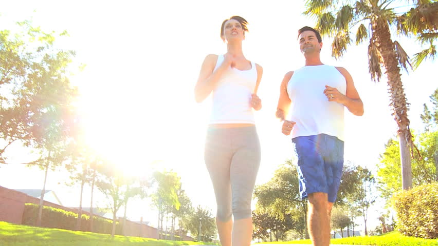Athletic caucasian couple jogging to keep fit - HD stock footage clip