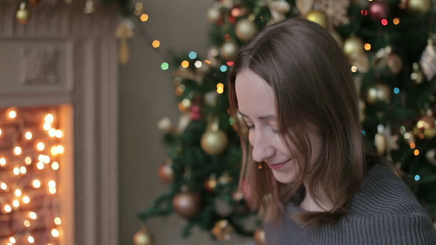Happy young woman opening Christmas present box | Shutterstock HD Video #12776504