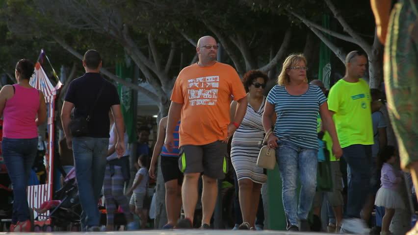 05 November 2015 - Gran Tarajal, Fuerteventura, Canary Islands, Spain - People walking on the sidewalk in town