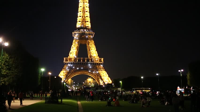 FRANCE, PARIS - SEP 9, 2014: People near Eiffel Tower at night. Eiffel Tower - it is one of the most visited places in France | Shutterstock HD Video #12823700