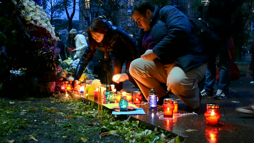 KIEV, UKRAINE - NOV 14, 2015: Flowers and candles memorable memorial set up near the French Embassy in Kiev, Ukraine on November 14, 2015 for the victims killed in attacks in Paris (France) on 13.11.15.