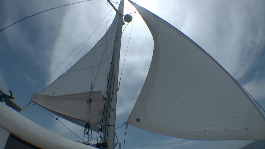 Sail of yacht against cloudy sky.  - HD stock footage clip