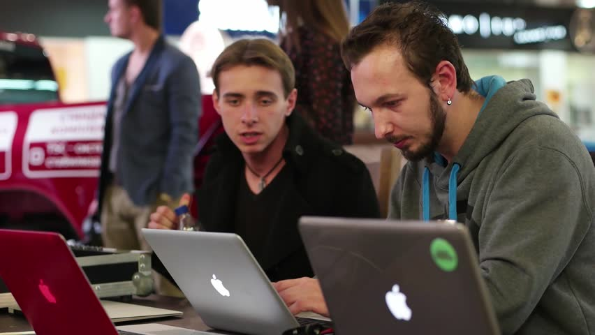 Kherson, Ukraine - 07 November 2015: Programmings open forum - Programmers working on laptops and communicate with each other discussing the code and developing applications. | Shutterstock HD Video #12852725