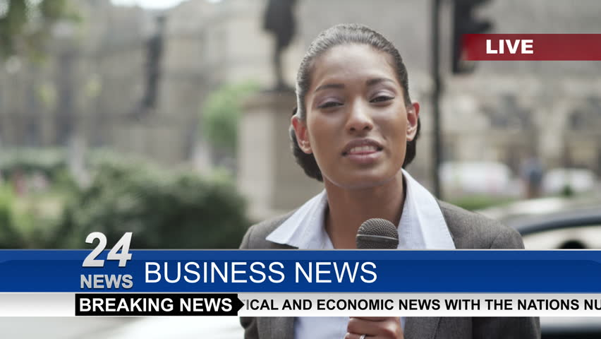 4K Female news reporter doing live piece to camera outdoors in the city of London. Shot on RED Epic.