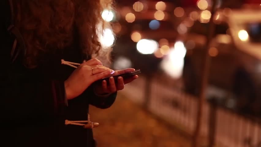 Image result for girl using phone at night on road