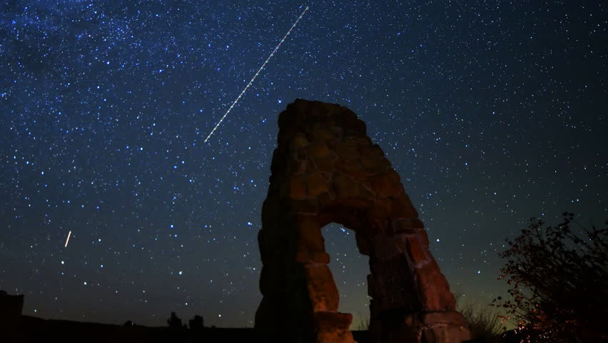 Astrophotography time lapse footage of milky way galaxy over scenic abandoned brick ruin at Knapp's Castle in Santa Barbara, California -Long Shot-