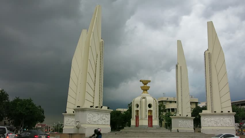 Bangkok, Thailand - November 2, 2014 - Black cloud over Democracy monument, Bangkok. It is a place where many key political activities in Thailand have taken place such as Student's Uprising 1973.