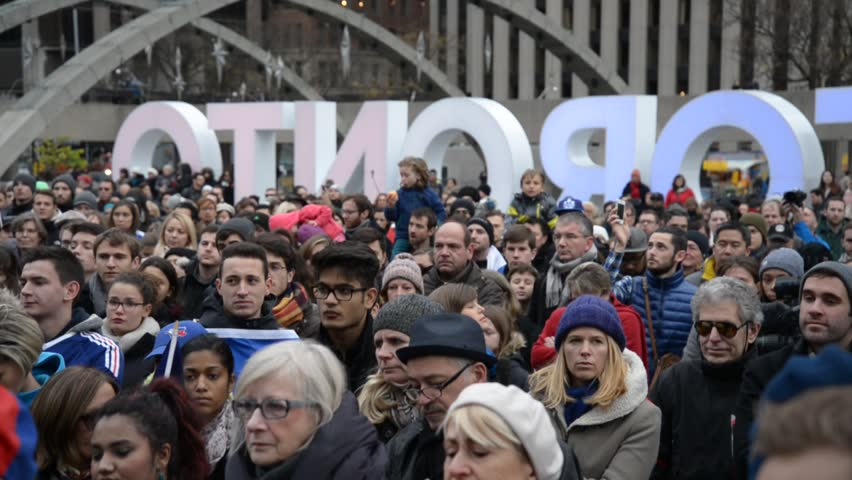 TORONTO, ONTARIO/CANADA: 14th November Saturday 2015: Hundreds of people paid tribute to victims of deadly attacks in Paris during a vigil at Nathan Phillips square in Toronto,Canada  - HD stock video clip
