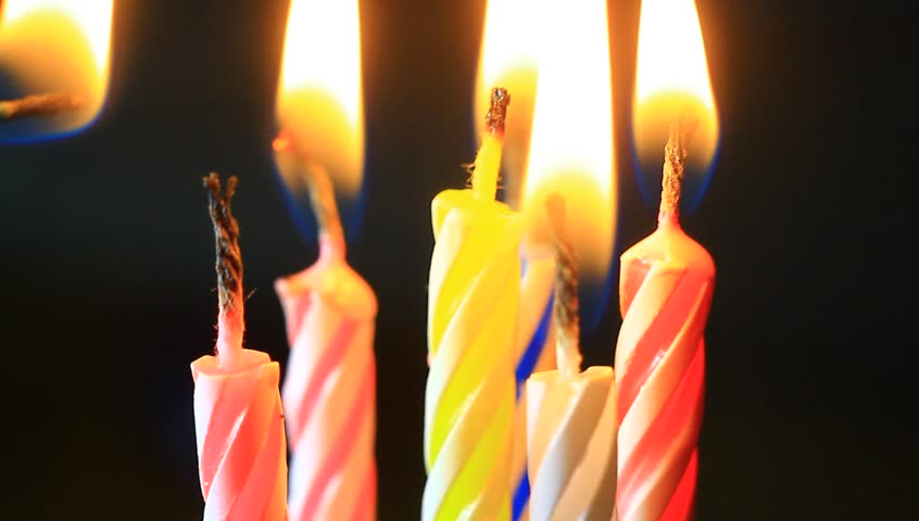 Birthday candles macro clip. Candles slowly burning down.