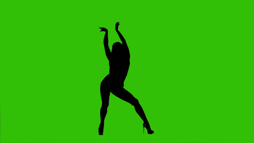 Silhouette of dancing female on a green background. High heels dance - HD stock video clip