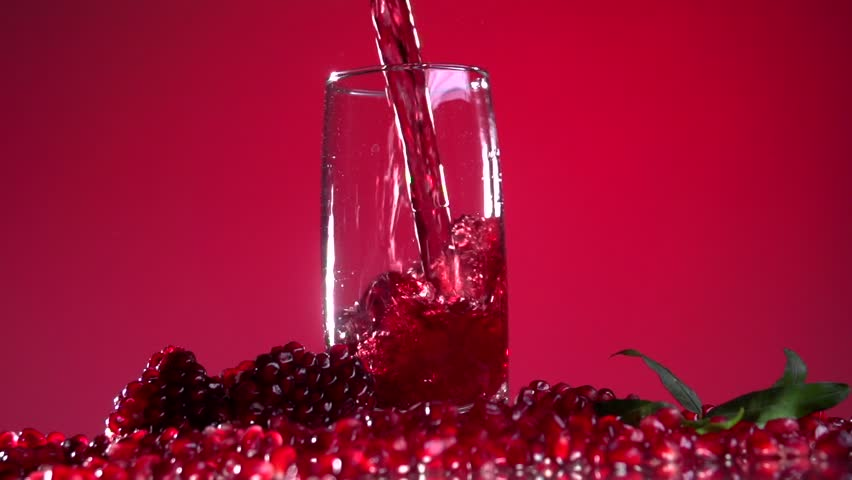 Slow Juicer Pomegranate : Milk Flow Fills Pomegranate Seeds Stock Footage video 6896572 - Shutterstock