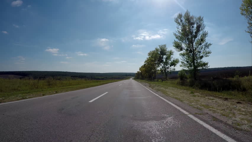 Driving on the highway near the forest. Video 4k, UHD. - 4K stock footage clip