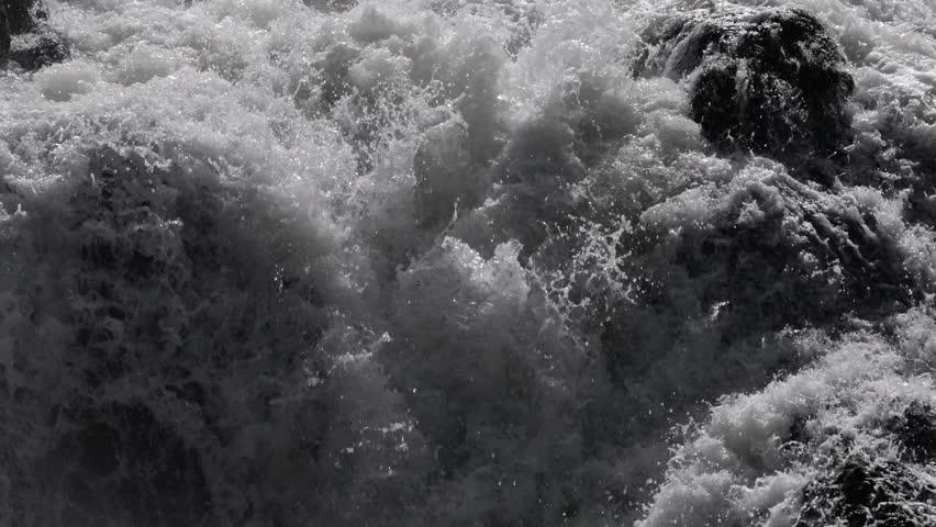 Dark dangerous white water in river flowing over rocks in slow motion - HD stock footage clip