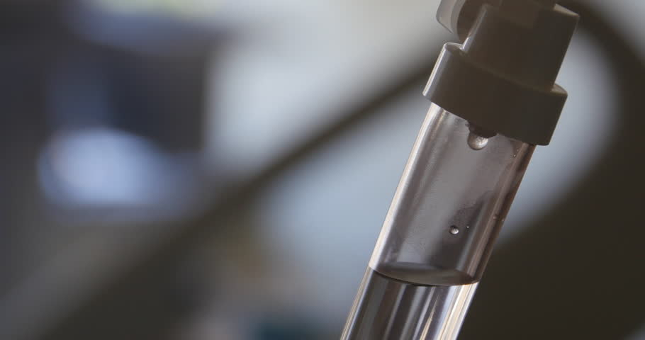 """An IV drips through the drip chamber. Intravenous simply means """"within vein"""".  Intravenous infusions are commonly referred to as drips  - 4K stock footage clip"""