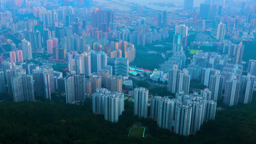 Hong Kong evening aerial view of dense populated area of Kowloon. 4K resolution time lapse panning. October 2015.   Shutterstock HD Video #13043120