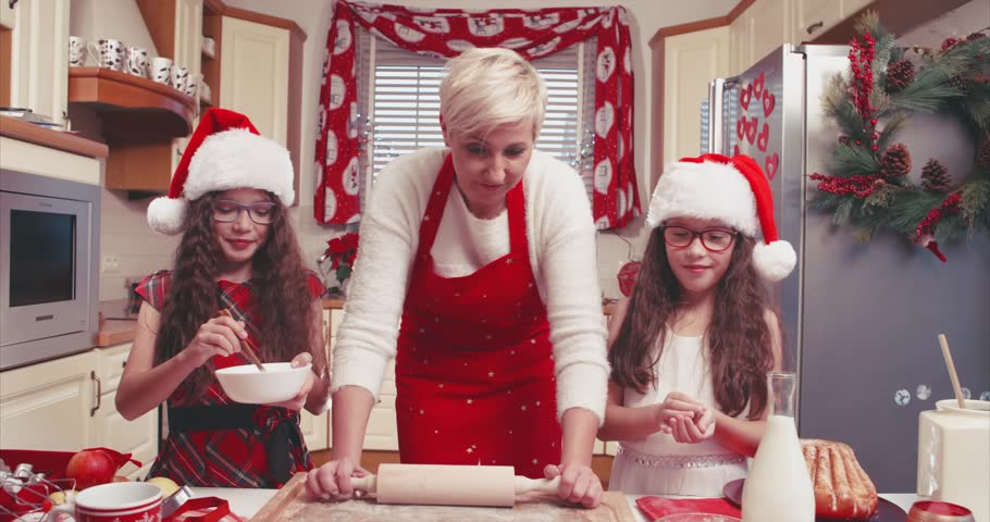 Family preparing christmas gingerbread in the kitchen, flat color - 4K stock footage clip
