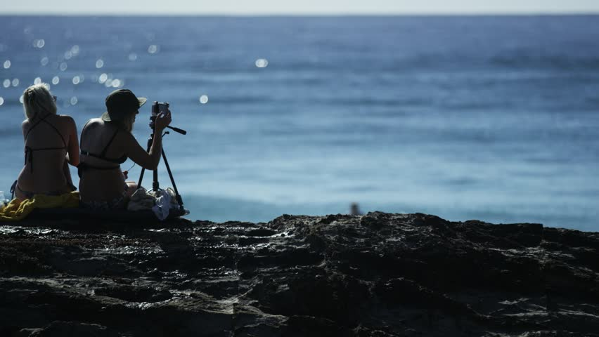 Two Girls on the Rocks with a Camera - HD stock video clip