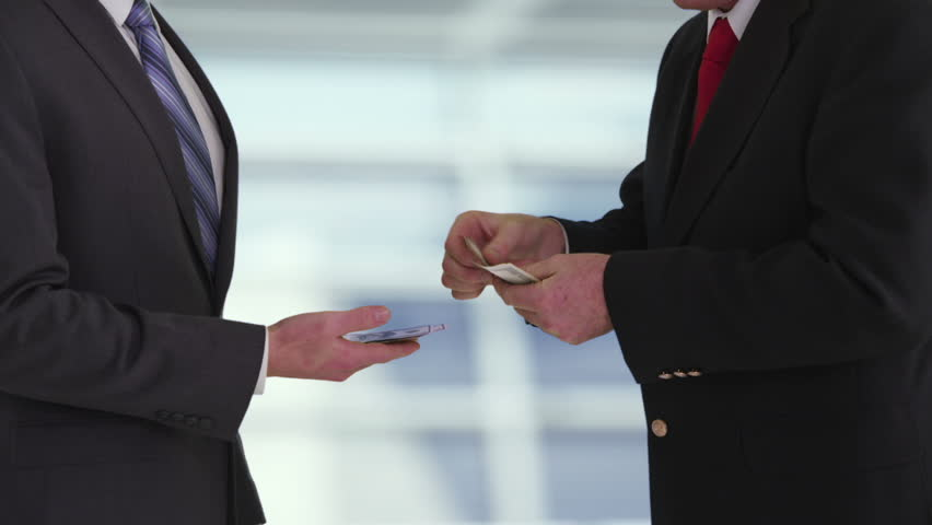 Cinemagraph - Businessman giving bribe in office. Looping Motion Photo.