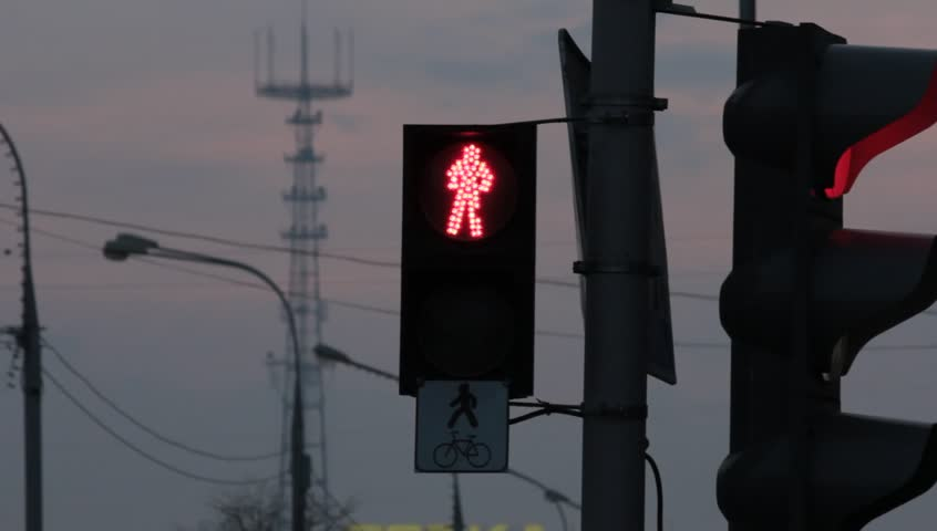 Ungraded: Traffic light reeling in the wind. Source: Canon EOS, ungraded H.264 from camera without re-encoding. (av3262u) - HD stock video clip