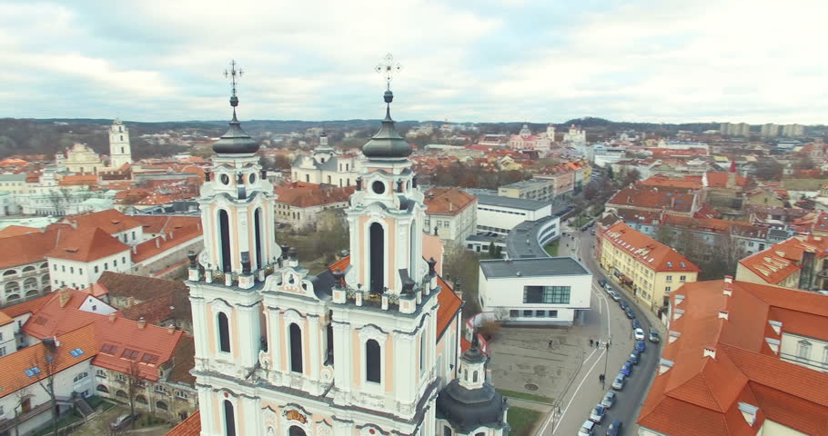 AERIAL. Smooth 360 flight around beautiful  Church of St. Catherine (Kotrynos) in Vilnius old town, Lithuania. Panorama of Vilnius old town.
