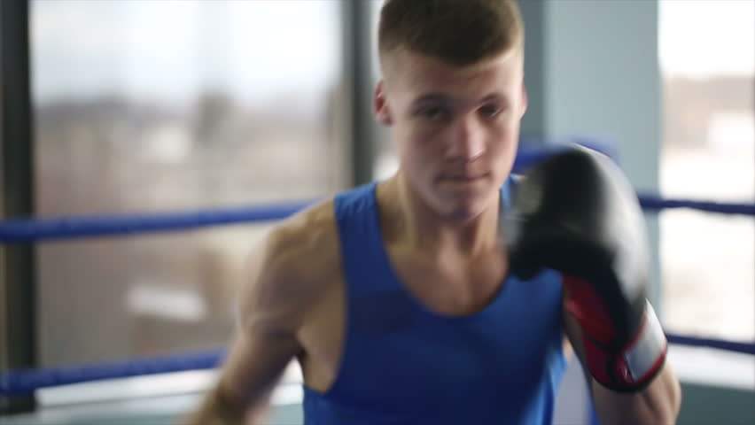 Young boxer workout. Slow motion | Shutterstock HD Video #13125056