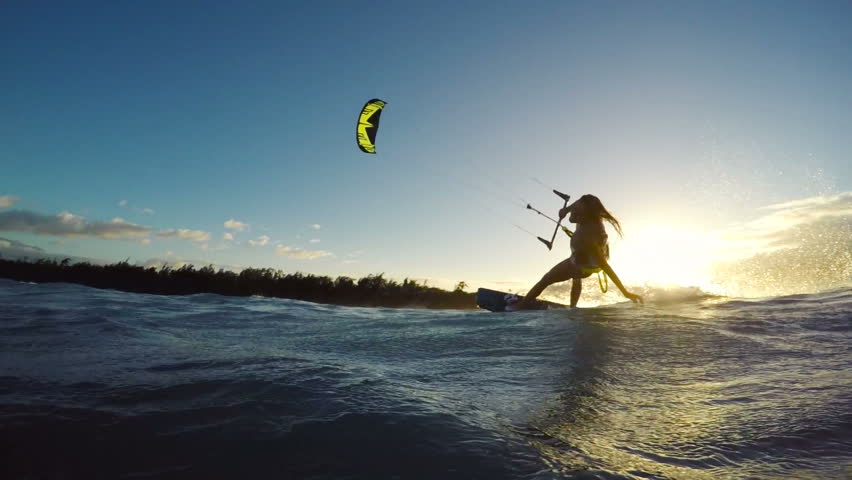 Extreme Kitesurfing at Sunset. Summer Ocean Sport in Slow Motion. Girl Kite Surfing in Bikini | Shutterstock HD Video #13139564