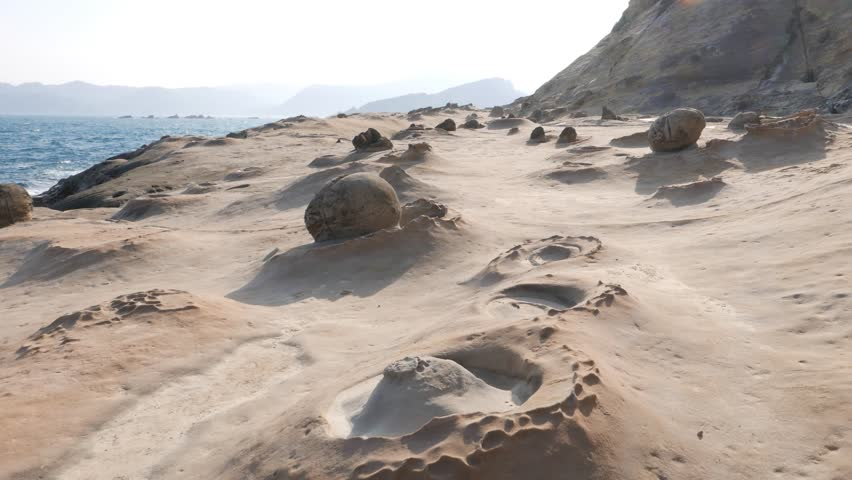 POV walk forward at otherworldly geological formations, Yehliu Geopark cape, famous natural wonder, odd rock created by volcanic and weathering. First person view camera smoothly move ahead #13142768