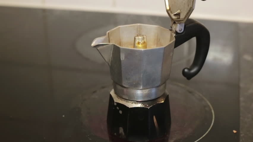 Italian coffee sprinkling out of a moka pot, italian traditional coffee maker, on a induction stove. Good morning symbol. | Shutterstock HD Video #13143776