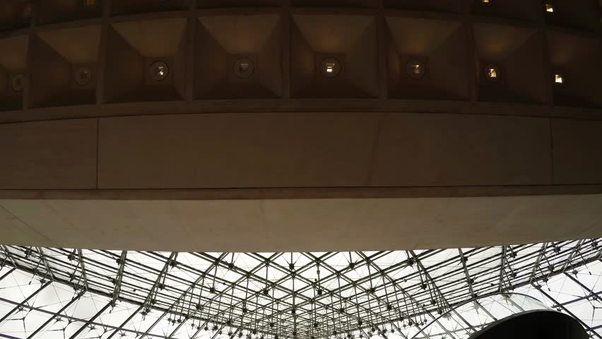 PARIS, FRANCE - AUTUMN, 2015: The ceiling glass pyramid at the Louvre museum in Paris. France. Shot in 4K (ultra-high definition (UHD)). - 4K stock video clip