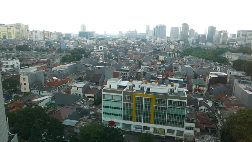Camera move back from aerial city view in twilight, to empty room. Kebon Kacang district in central Jakarta. Full height windows from floor to ceiling, camera move backward #13184258