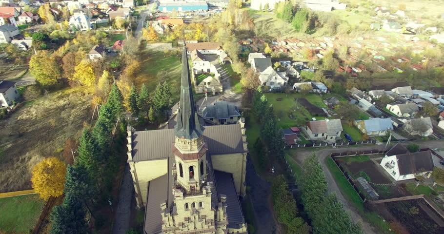 AERIAL. Smooth 360 flight around beautiful Church of St. Casimir in Vilnius, Naujoji Vilnia Lithuania. Panorama of Naujoji Vilnia