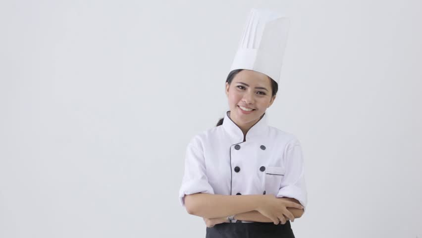 happy young female chef on white background - HD stock video clip
