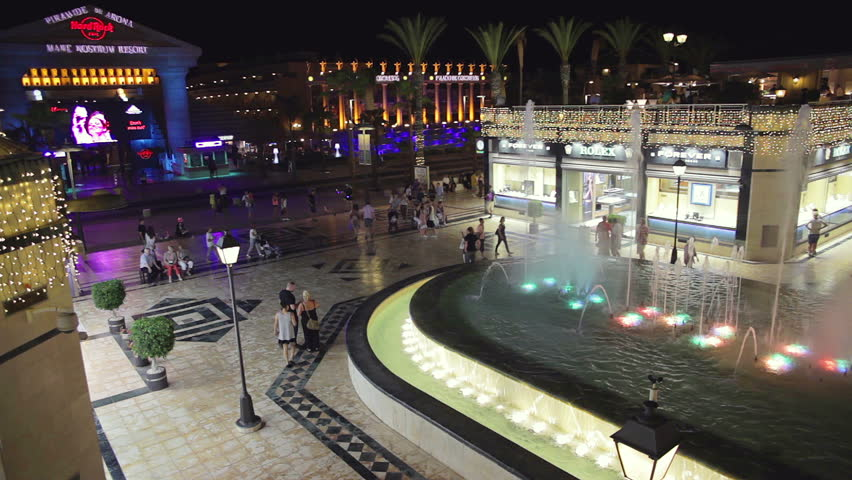 Tenerife, Spain-September 22, 2015: Night life in Av. las Americas, Playa de la Americas. Las Americas is one of the most popular and well-known resorts with plenty of restaurants and shopping stores