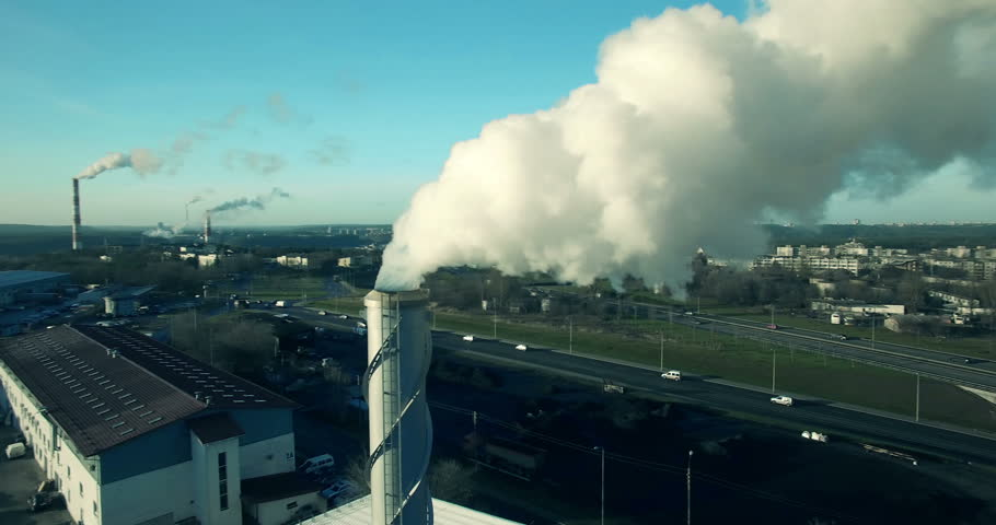 AERIAL. Point of interest (orbit) flight around factory chimney with grey smoke. Industrial pollution