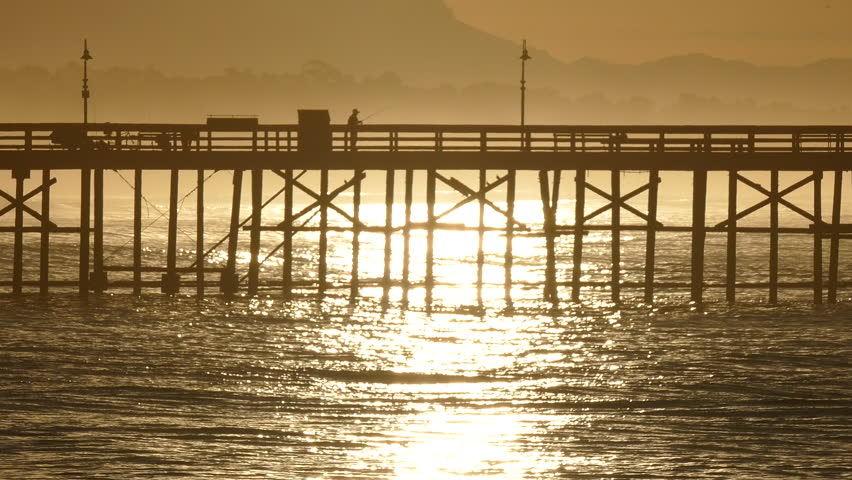 Ventura pier high surf sunrise with zoom in Southern California. - HD stock footage clip